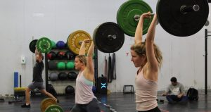 Members lifting weights